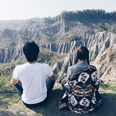 a couple meditates on a mountain in taiwan